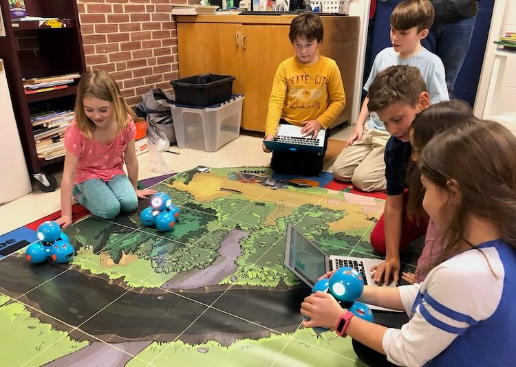 Students coding Dash and Dot robots to compete in competition at Newington Public School.