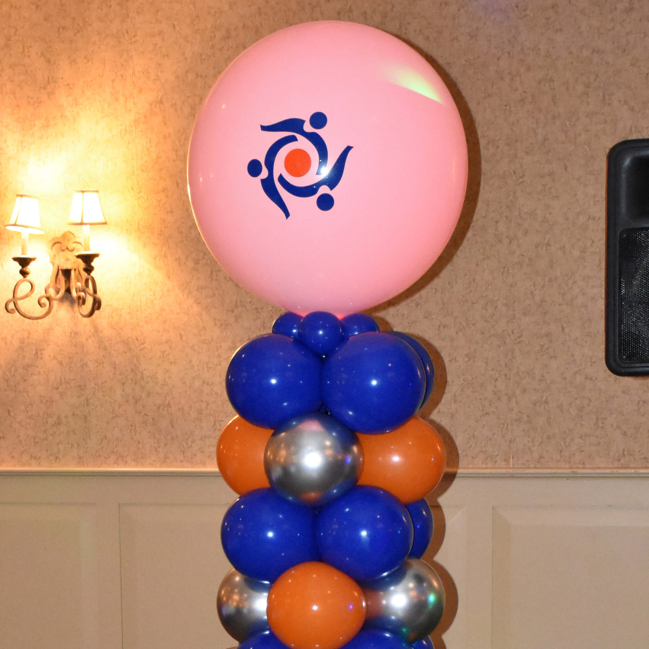 Lighted balloon column with custom logo for a local non profit.