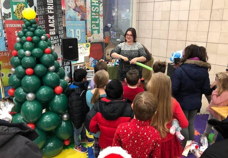 Kali entertaining crowds with our balloon gameshow at the Fox Run Mall in Newington, NH.