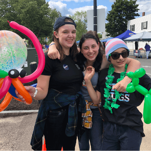 A group of happy teenagers with balloon sculptures at the Rochester PRIDE event in Rochester, NH.