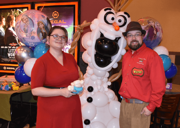 Wayne and Kali with a large balloon Olaf sculpture from the movie Frozen. Regal Cinemas in Newington, NH.