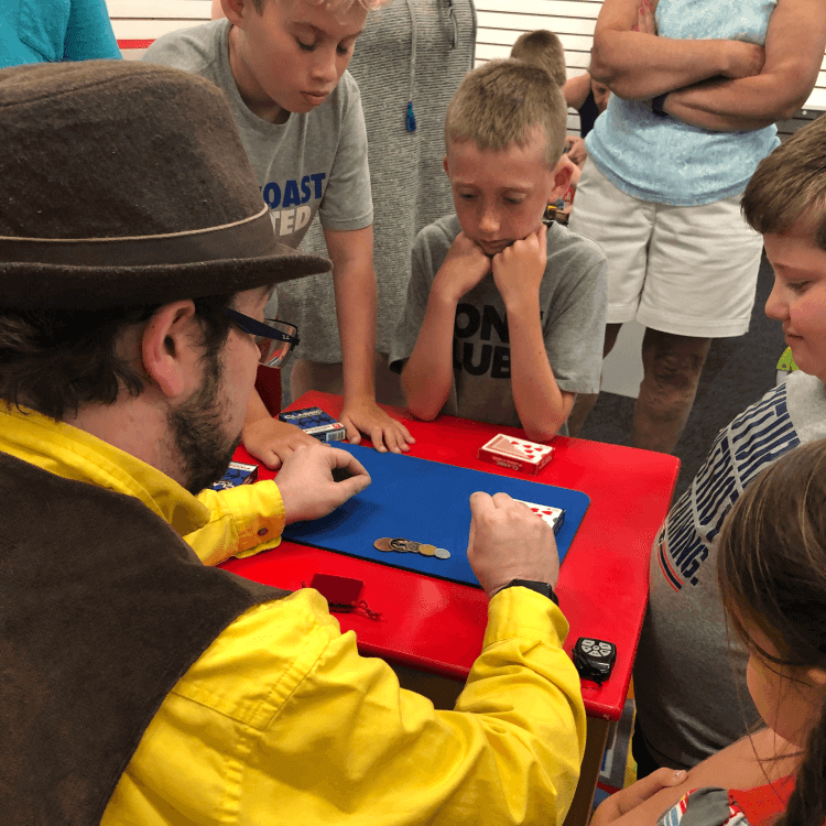 Wayne teaching magic to a group of kids at G.Wiliker's Toystore in Portsmouth, NH.